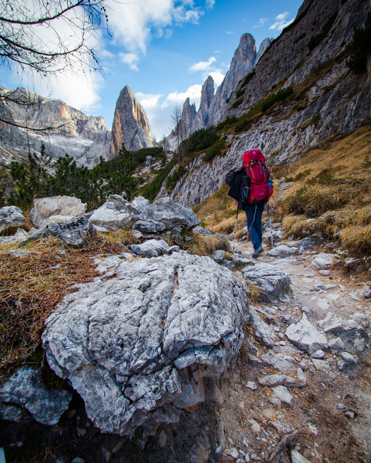 Woman hiking in the Dolomites with a Deuter SL 60 backpack