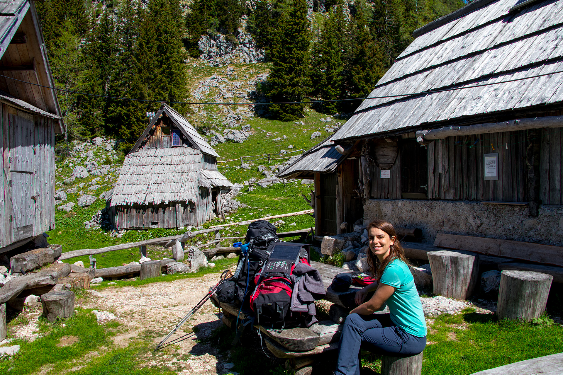 Woman sitting at Planina Viševnik / Mountain Pasture Visevnik