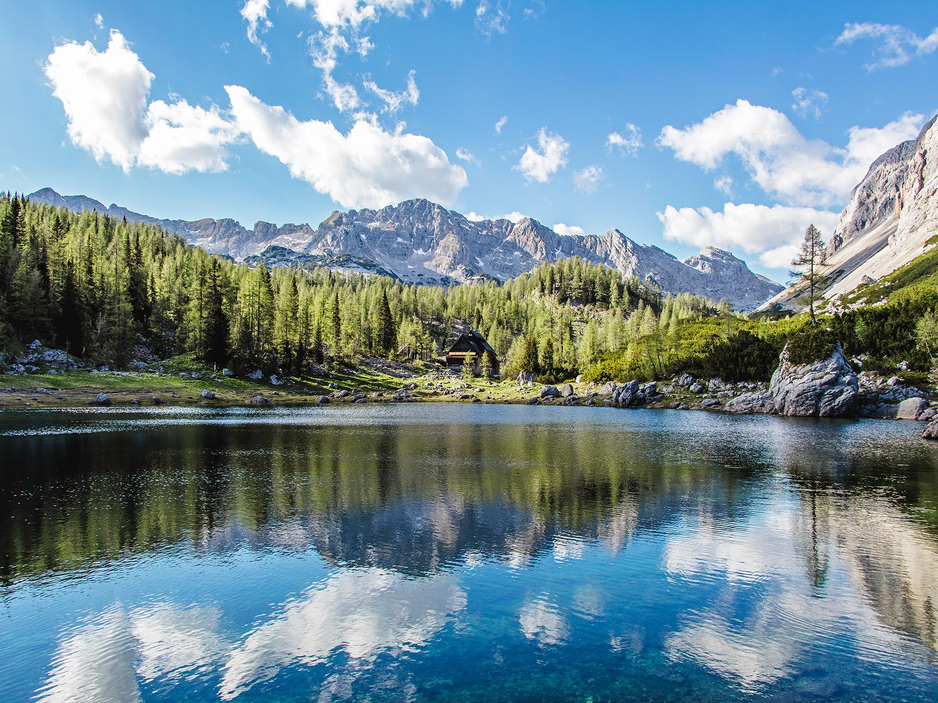 Reflection on water Walking on water at Koča Pri Triglavskih Jezerih/ Dvojno Jezero