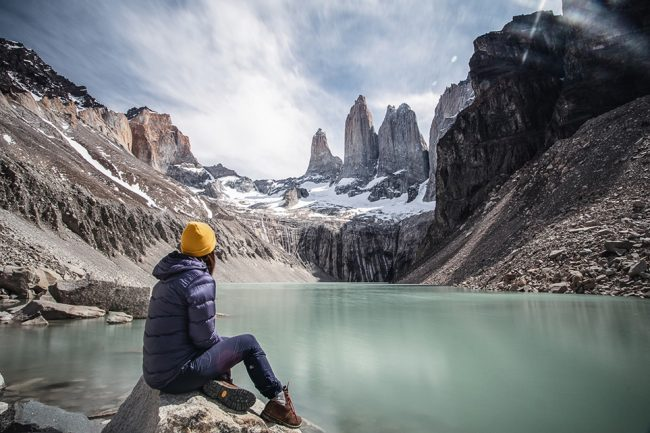 Woman sitting at Mirador Base Las Torres | A complete guide to the O Trek