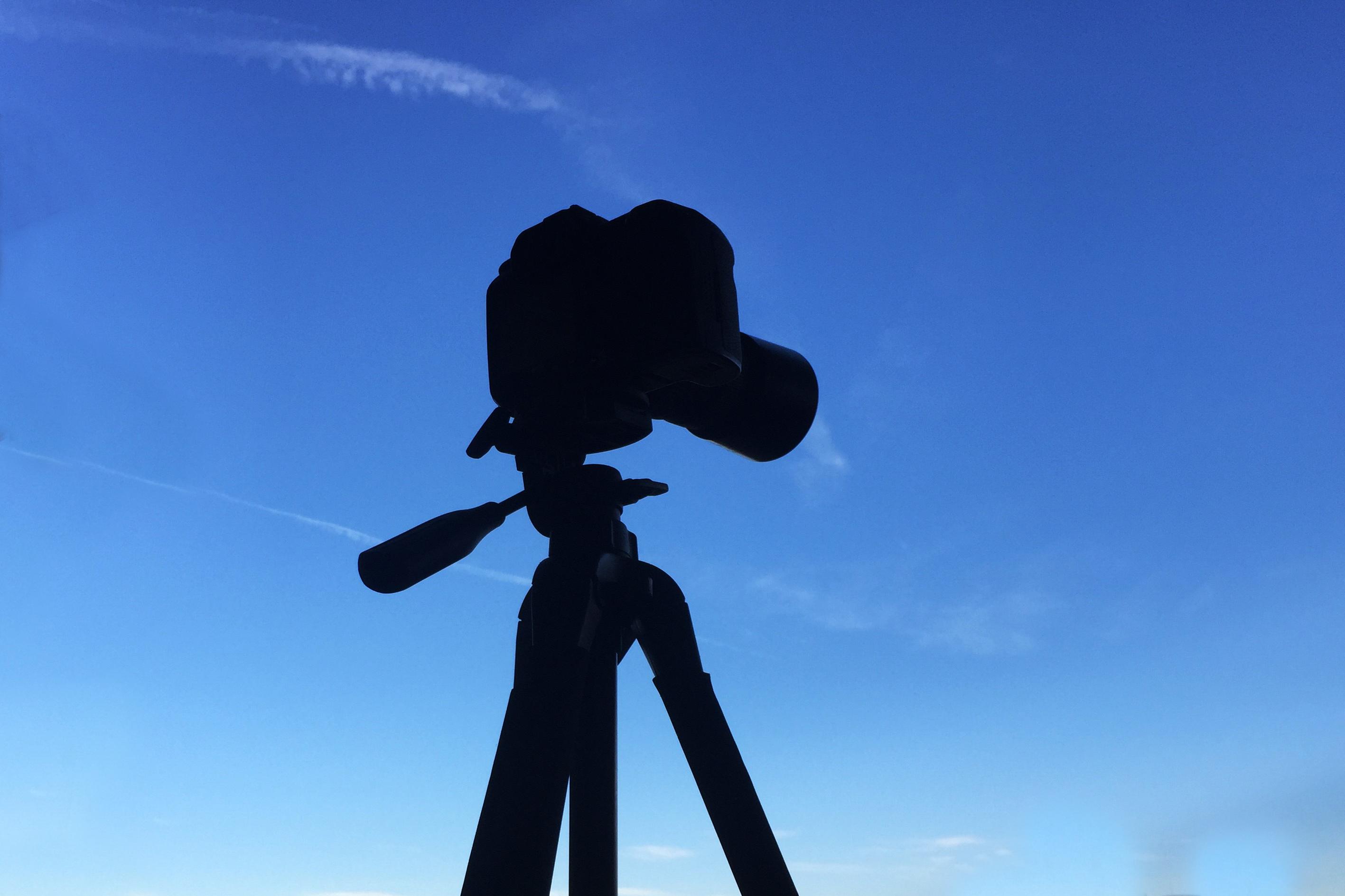 Tripod shadow with blue sky
